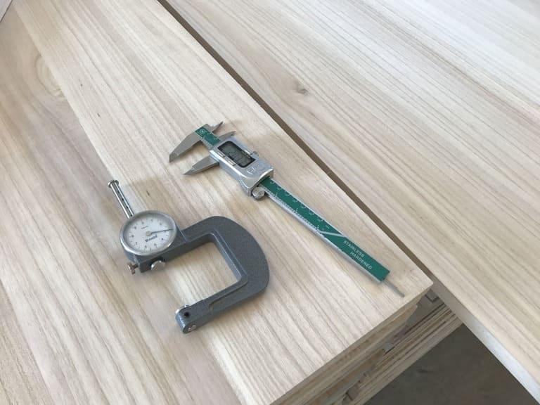 Paulownia wood strip board with tools.